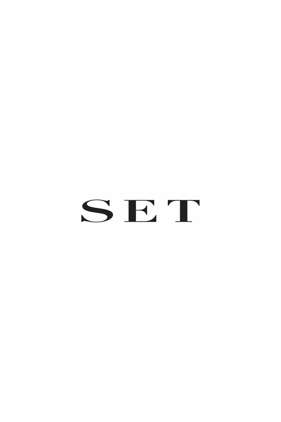 Coat with houndstooth pattern and frills